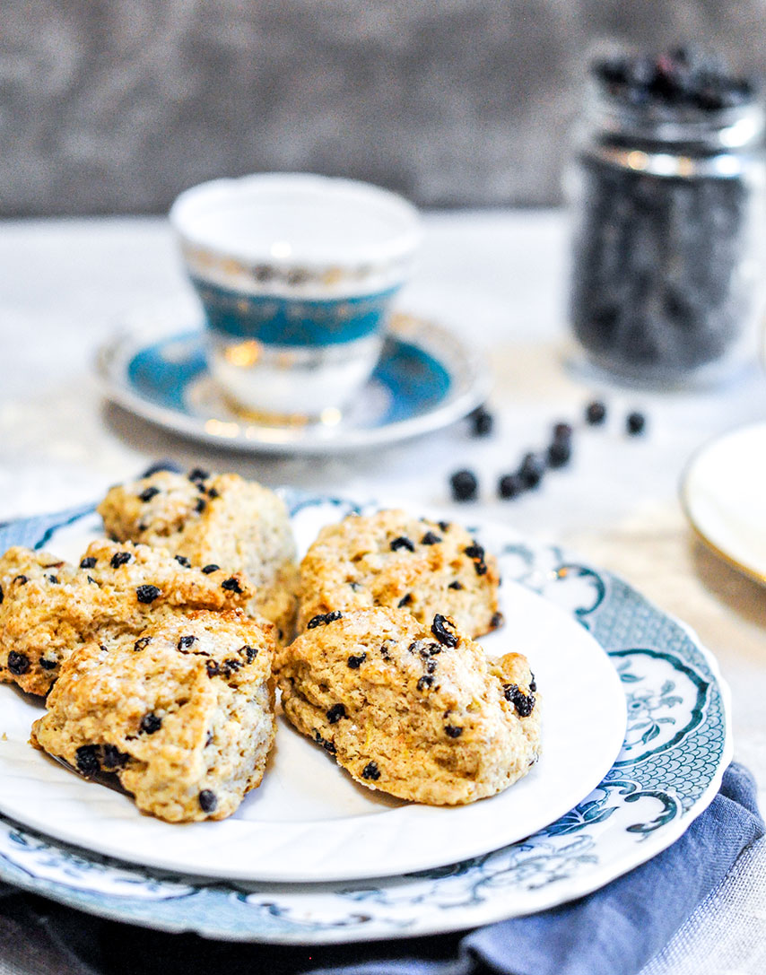 scones on plate with tea in background