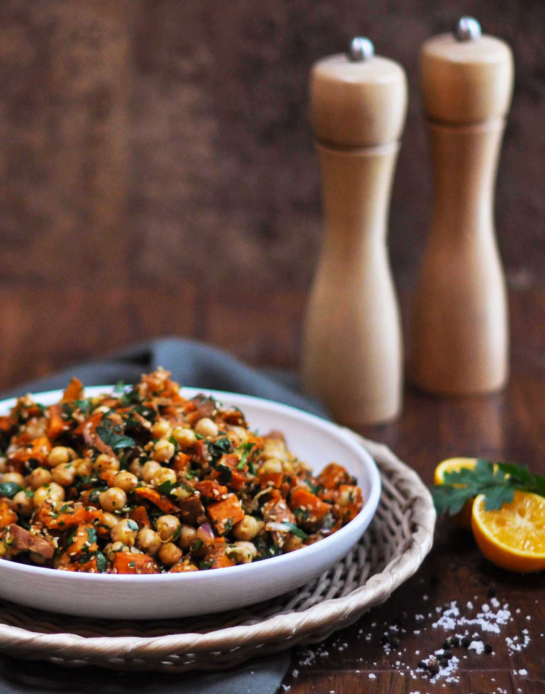 chickpea sweet potato salad on wood board