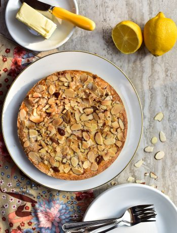 image of a almond cake with lemons in background