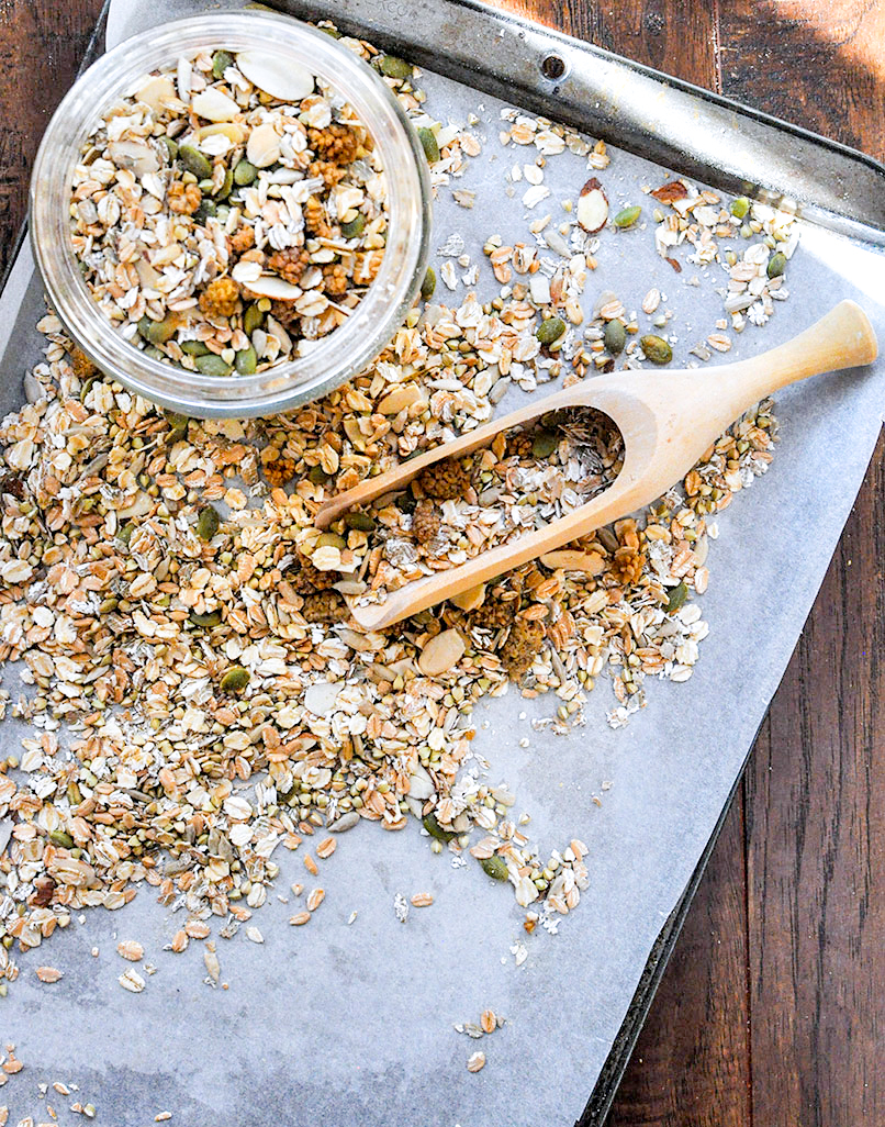 muesli on a baking sheet with scoop