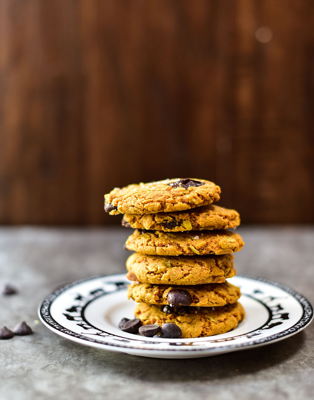 side view of a stack of 6 cookies on a white plate with animal designs