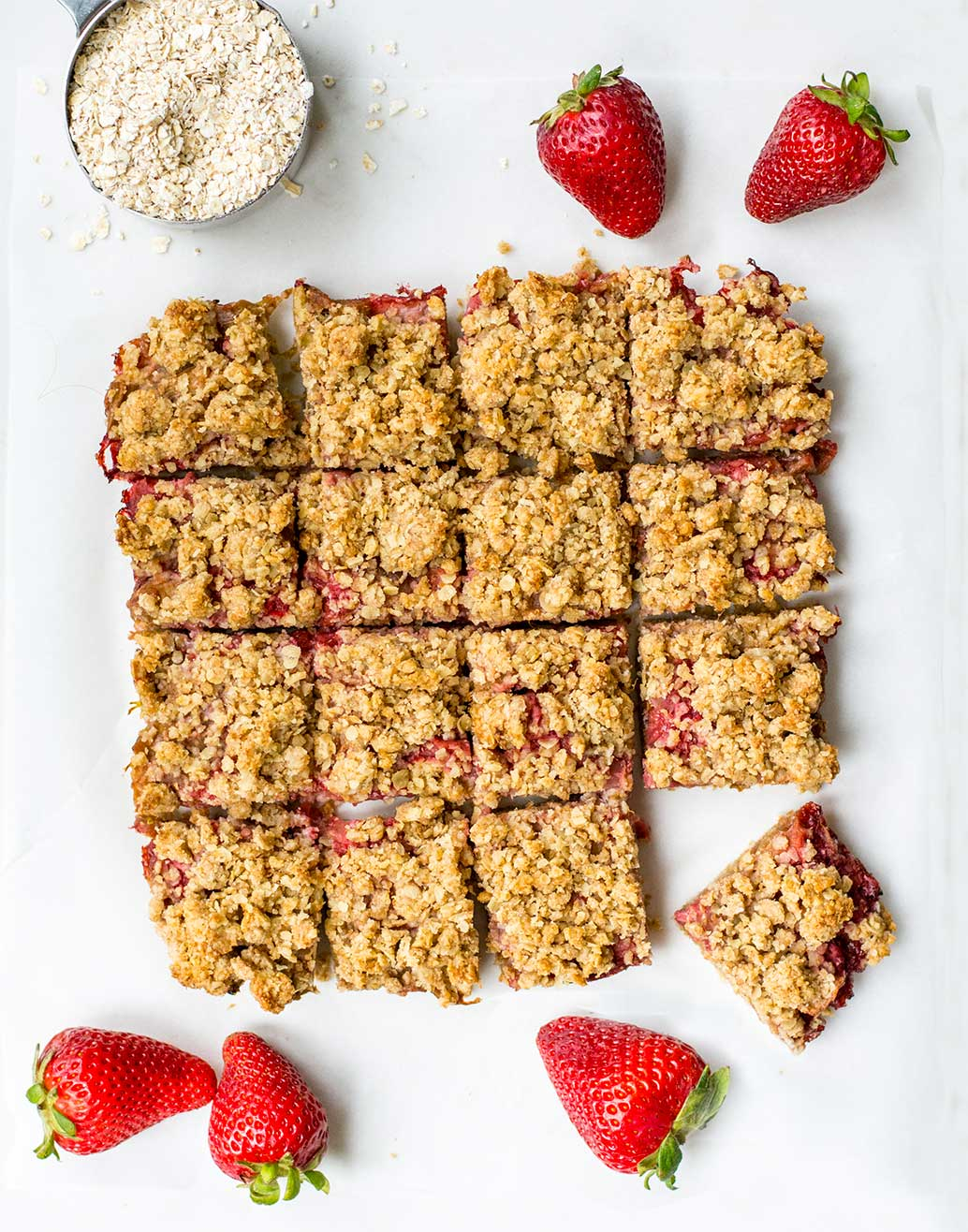 rhubarb bars top with strawberries