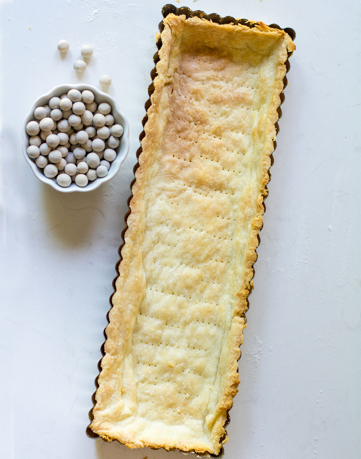 baked tart shell with pie weights