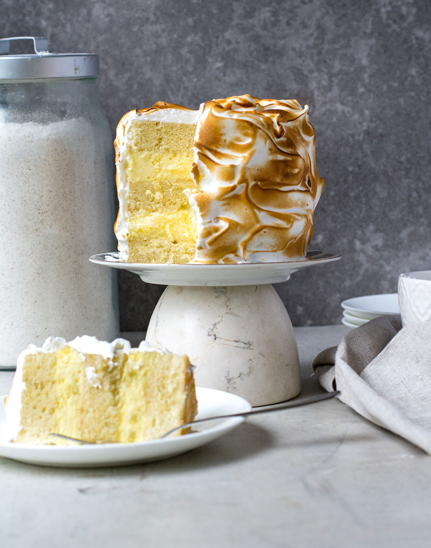 lemon meringue cake with slice cut