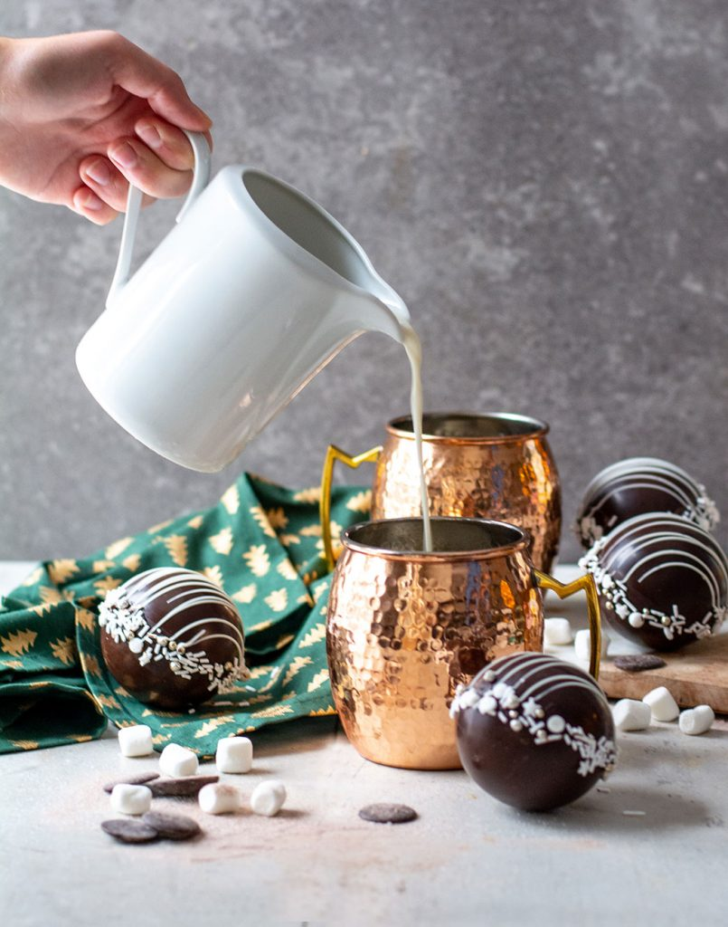 pouring milk into hot chocolate