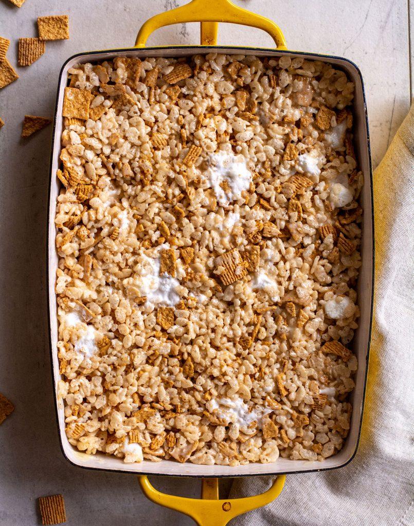 rice krispie squares in pan before being cut
