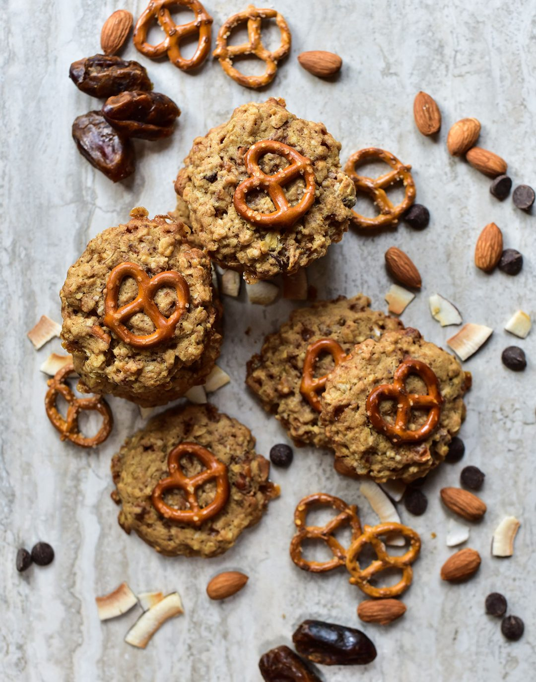 top view of pretzel oat cookies with chocolate chips, almonds and dates