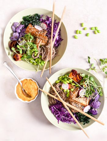 buddah bowls with purple cabbage and tofu with chopsticks