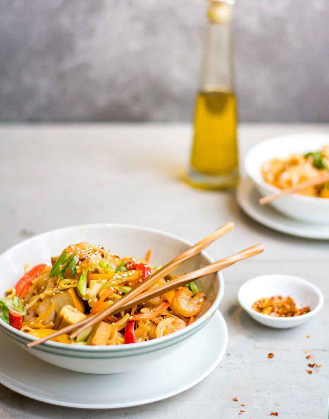 Pad thai in bowl with chopsticks