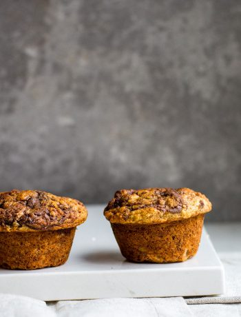 Side view of banana muffins on white board