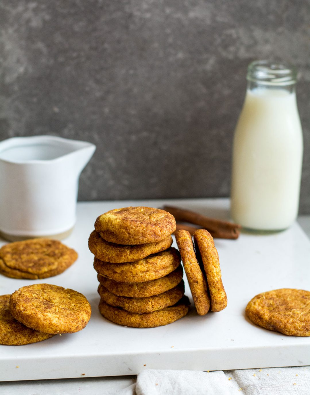 Stack of cookies with milk in background